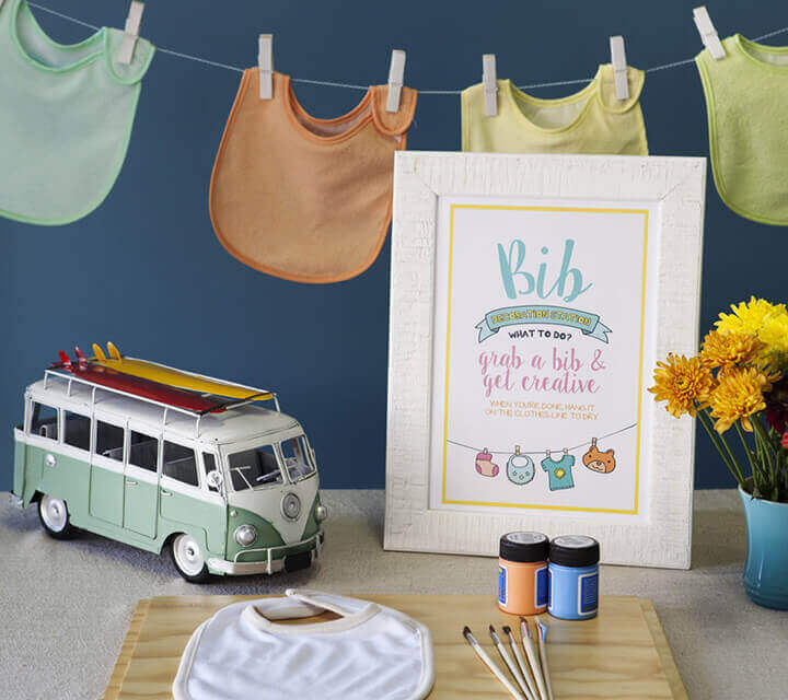 Baby Shower game ideas - Decorate a baby bib!